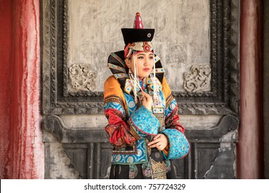 Young Mongolian woman in a traditional 13th century costume in a temple. Ulaanbaatar, Mongolia.