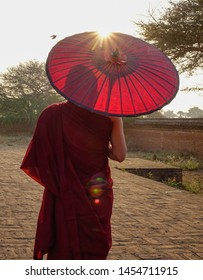 A young monk standing at Buddhist pagoda in Bagan, Myanmar.