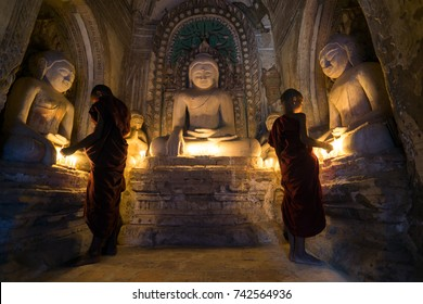 Young Monks Pray Inside Bhuddist Pagoda Temple in Bagan, Myanmar. 8/10/2016