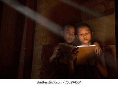 Young monks reading in monastery