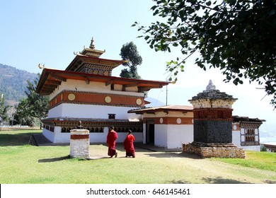 Young monks walking in Chimi Lakhang or Chime Lhakhang temple, Buddhist monastery in Punakha District, Bhutan