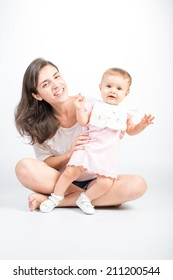 Young Mother with baby daughter on white background