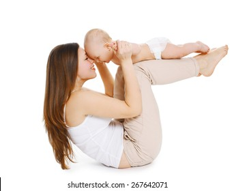 Young mother and baby are doing exercise and having fun on a white background