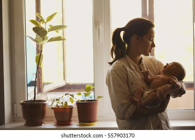 young mother with baby at home