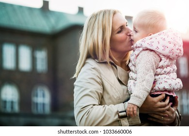 Young mother and baby outdoor at spring