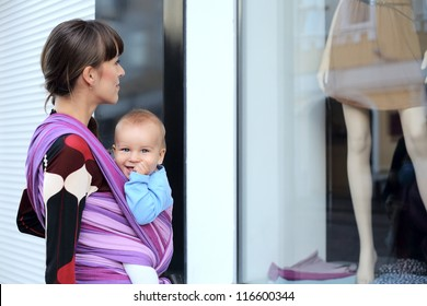 young mother with baby in sling