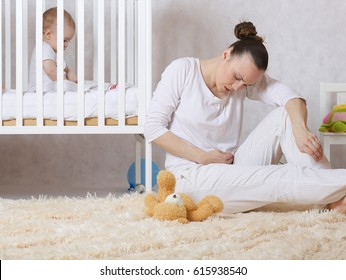 Young mother between 30 and 40 years old is experiencing postnatal depression.