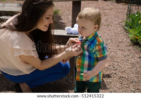 11933988740e Young Mother Changes Clothes Her Small Stock Photo (Edit Now ...