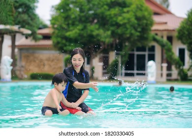 Young mother and child enjoying  in the pool,Child having fun in water with mom