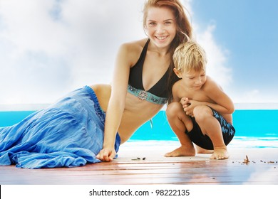young mother and child on beach
