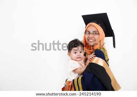 f81fe386bf5 Young mother college graduate with her daughter after convocation ceremony.