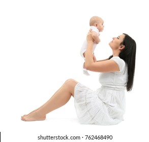 Young mother and cute baby, isolated on white
