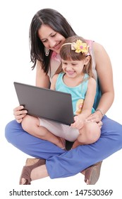 Young mother and daughter looking at laptop.    Focus in the mother.