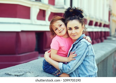 Young mother and daughter on a walk in the city
