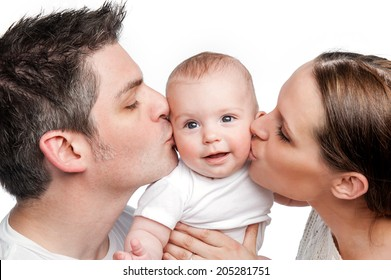 Young Mother Father Kissing Baby. Studio shot on white background..