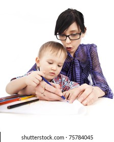 Young mother with glasses and son draw with crayons isolated white background