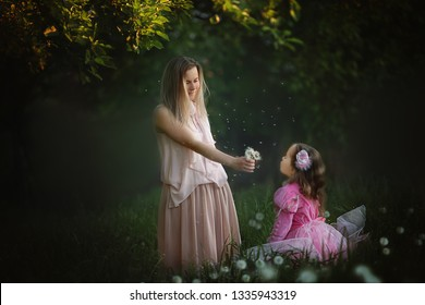 Young mother having fun with daughter outdoors
