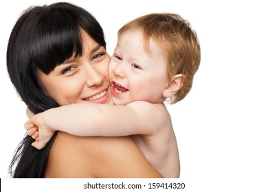 Young mother with her baby after bathing in a white towel