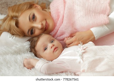 young mother with her baby in Christmas