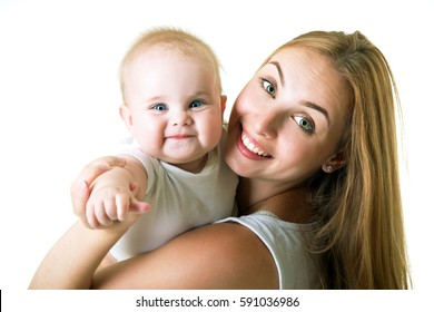 Young mother with her baby daughter happy smiling, studio portrait, over white.
