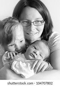 Young mother and her children. Close up with shallow DOF.