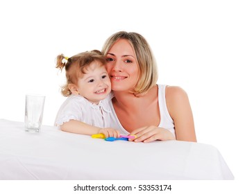 young mother and her young daughter hugged and kissed each other on a white background
