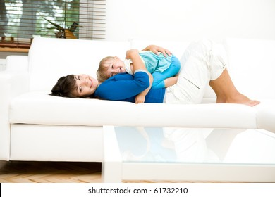 young mother and her daughter playing at home