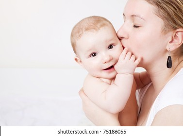 young  mother and her six months old baby at home
