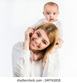 young mother with her six-month daughter. Isolated on white background