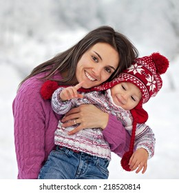 Young mother and her son in a winter day