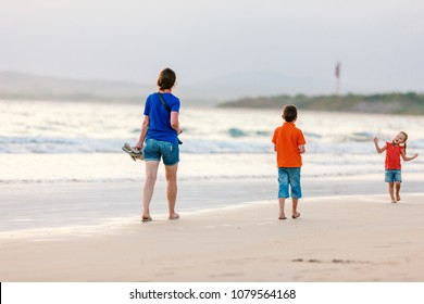 Young mother and her two kids at a beach