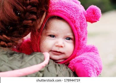 young mother with her two month baby outdoor