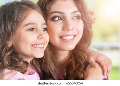 young mother hugging little daughter