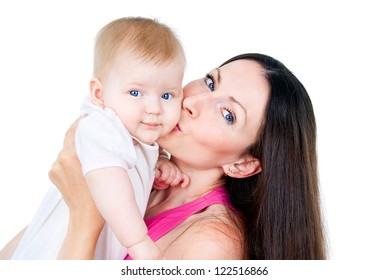 young mother kissing a child isolated on white background