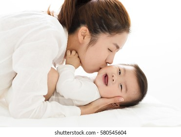 young Mother kissing sweet baby boy