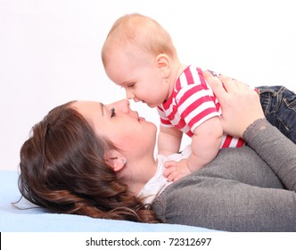 Young mother with little baby.