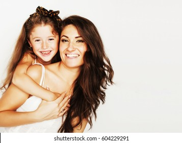 young mother with little cute daughter emotional posing on white