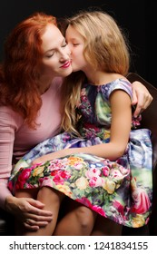 Young mother and little daughter gently embrace. The concept of Happy Childhood, Family Happiness, Raising a Child.
