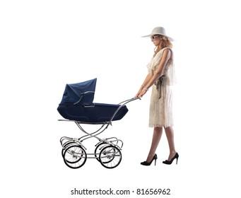 Young mother pushing a pram
