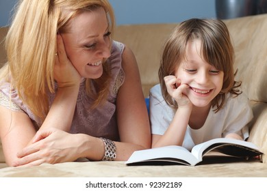 Young mother read book with her son