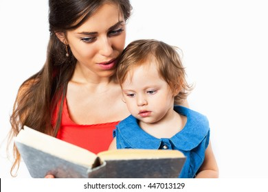 Young mother is reading a book with her daughter. White background