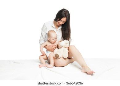 Young mother sitting with cute baby boy
