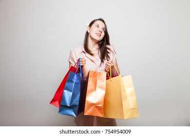 Young mother smiles carrying products to family