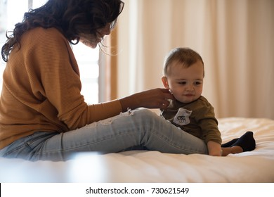 Young Mother spending time with her little baby