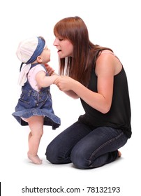 Young mother talking with her baby. Studio shot on a white background.