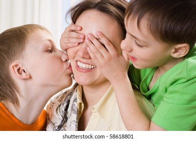 young mother with three children standing together
