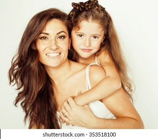 young mother with two children on white, happy smiling family inside isolated close up