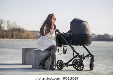 young mother walking with baby, good weather for walking, healthy lifestyle