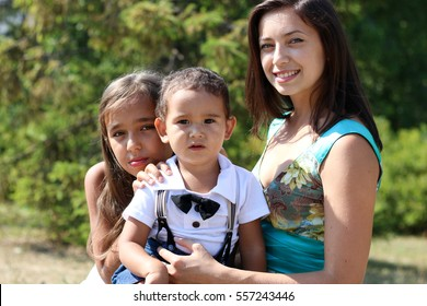 Young mother, younger sister and son,Summer snapshot