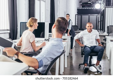young multiethnic business people talking while working together in office